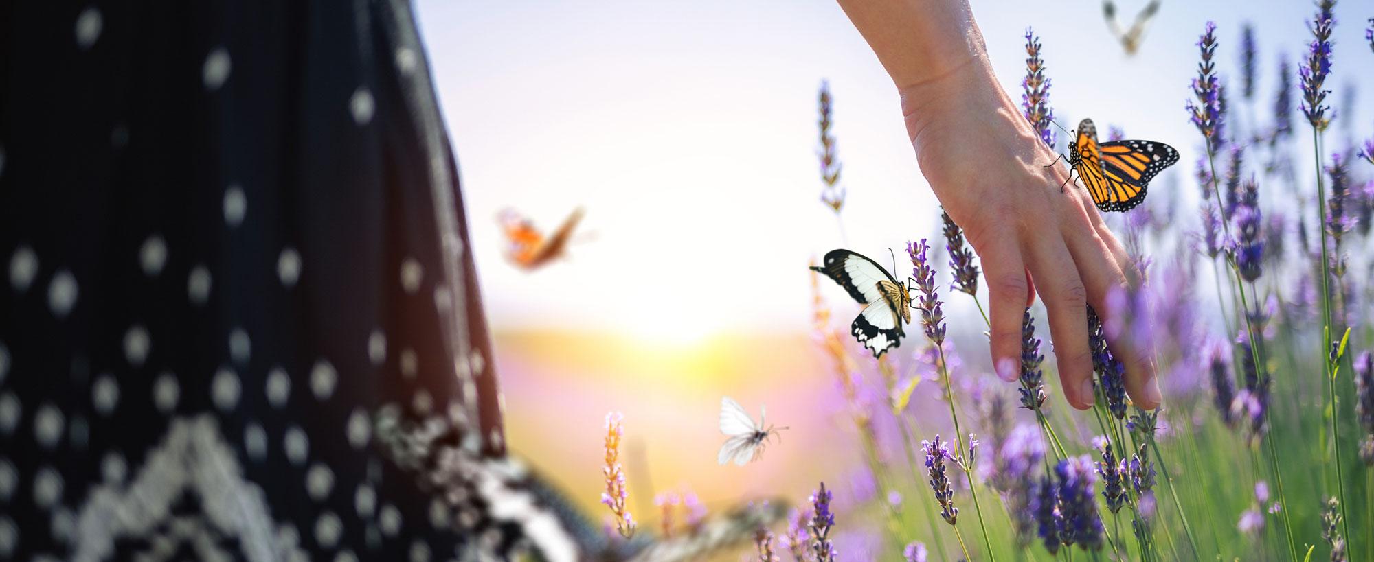 Woman walking with butterflies